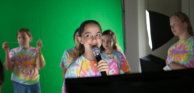 Campers wrote and performed newscasts in front of a green screen to produce final videos at the conclusion of the week.