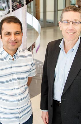 IGB faculty member Saurabh Sinha, a professor of computer science (left), with Director and professor of entomology Gene Robinson and an international consortium of 52 scientists used comparative genomics to discover the evolution of bee society is associated with increases in the complexity of gene regulation.