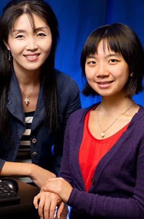 Professor and IGB faculty member Sua Myong, left, and graduate student Helen Hwang determined the action of proteins that regulate the caps on the ends of DNA strands, creating an assay that could be used to screen anti-cancer drugs.