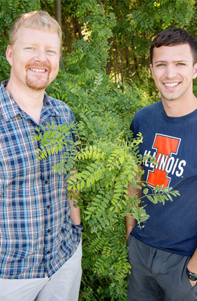 Researchers at the U. of I. found that plants vary a lot in the efficiency with which they uptake carbon dioxide and conserve water. Plant biology professor Andrew Leakey, left, mentored Kevin Wolz, who was an undergraduate at the time he conducted the research. Wolz now holds degrees in civil engineering and biology and is pursuing a doctorate in biology.
