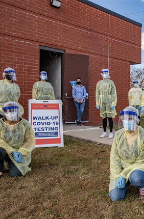 Workers gather at the Rantoul Parks and Recreation Department before hosting a pop-up test clinic. Rantoul has had outbreaks among essential worker populations, and the LHEAP team hopes to develop a better understanding of COVID-19 infection rates and why some areas generate acute infection clusters.