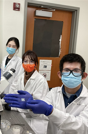 A team at the Holonyak Micro & Nanotechnology Lab displays new COVID-19 antibody test.