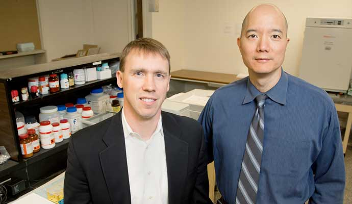 University of Illinois chemistry professor Paul Hergenrother, left, and veterinary clinical medicine professor Timothy Fan tested an anti-cancer compound in pet dogs that will be used in human clinical trials.