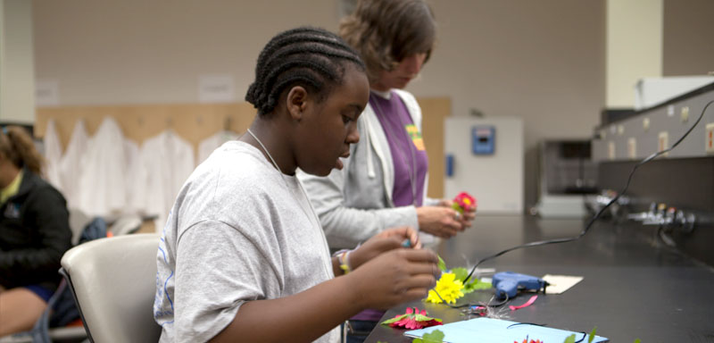 Building fiber optic flowers was one of the hands-on activities in the labs within the IGB.