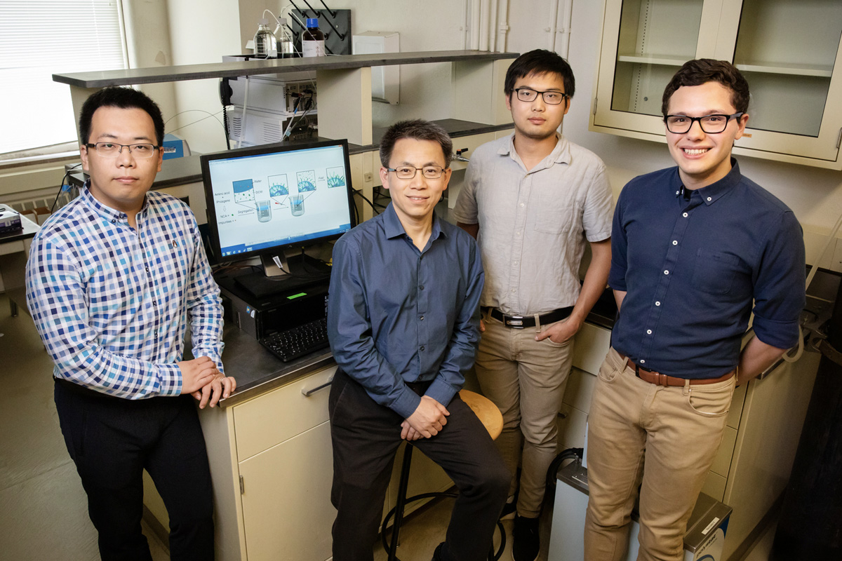 A team including, from left, postdoctoral researcher Ziyuan Song, professor Jianjun Cheng and graduate students Tianrui Xue and Lazaro Pacheco, developed a new method that streamlines the construction of amino acid building blocks that can be used in a multitude of industrial and pharmaceutical applications.