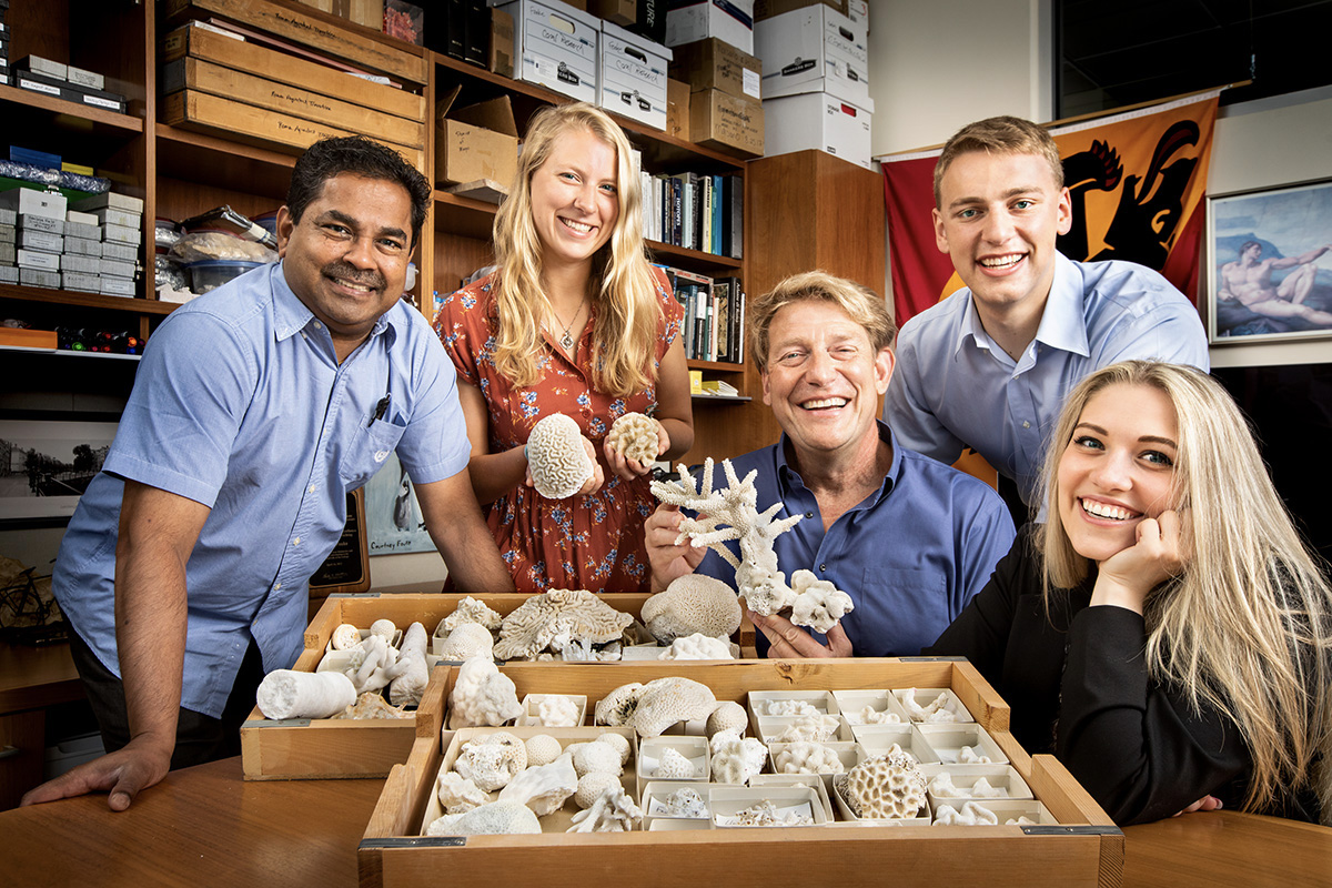 Using newly developed geological techniques, researchers, from left, microscopy expert Mayandi Sivaguru, Kaitlyn Fouke, geologist and microbiologist Bruce Fouke, Kyle Fouke, Lauren Todorov and their colleagues made discoveries about the formational history of Porites coral skeletons to fine-tune the records used to make global climate predictions.