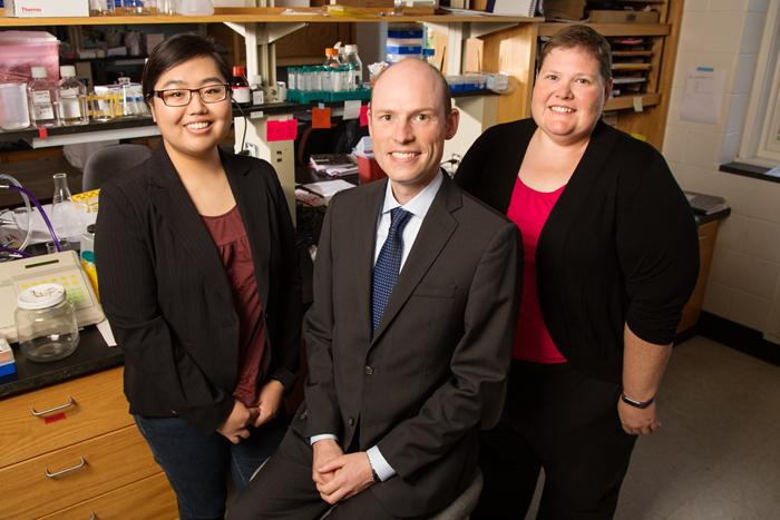 A cholesterol byproduct facilitates breast cancer's spread by hijacking immune cells, a new University of Illinois study found. Pictured, from left: Postdoctoral researcher Amy Baek, professor Erik Nelson and breast cancer survivor Sarah Adams.