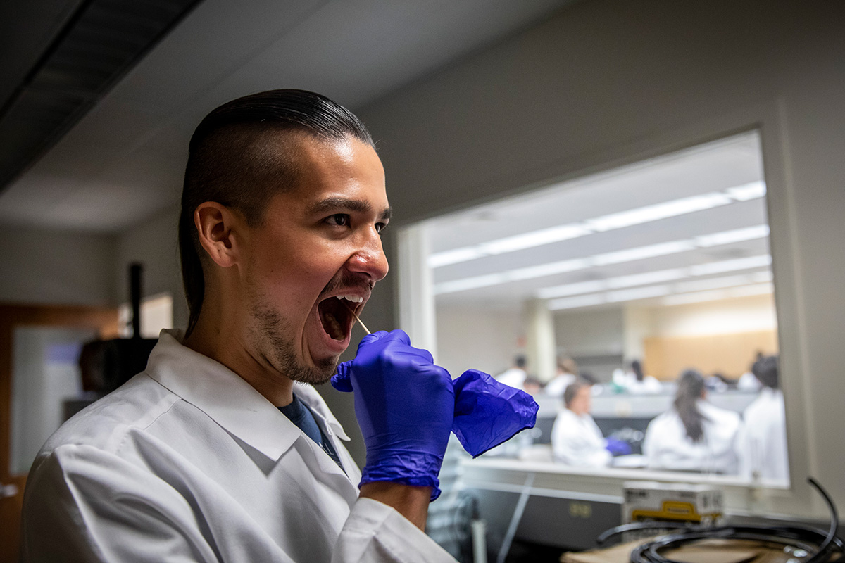 Duke University Ph.D. student Raymond Allen collects a cheek swab for analysis. All DNA samples and data were destroyed upon completion of the exercise.